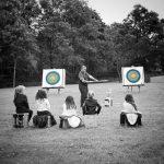 Children watching archery demo