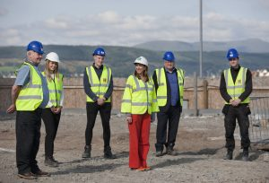 Pippa with Councillor Robin Currie with trainees, Francesca Wilson, Daniel Green and Jamie McBride