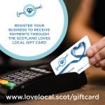 The Love Local gift card being used to pay for goods
