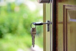 Keys opening a front door
